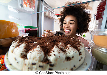 Woman Eating The Slice Of Cake