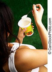 Eating Yogurt - Woman Eating Yogurt