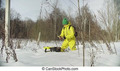 Woman ecologist getting samples of snow - Woman ecologist...