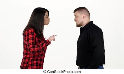 Woman edify to the man, he stands and silently nods. White...