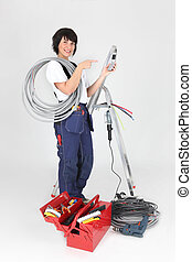 Woman electrician on white background