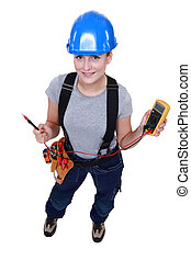 Woman electrician with multimeter
