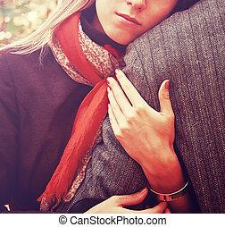 Woman embraces a man