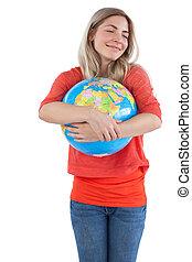 Woman embracing a globe