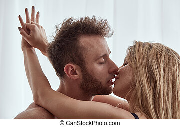 Woman embracing and kissing man - Beautiful, blonde woman...