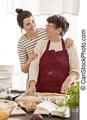 Woman embracing her grandma