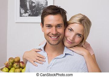 Woman embracing man from behind at