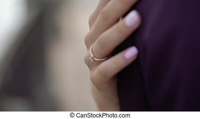Woman embracing man wit hand ring on a finger
