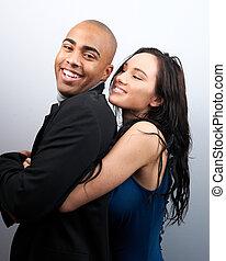 Woman Embracing Smiling Man
