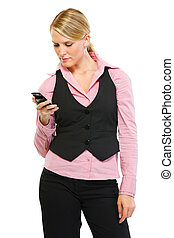 Woman employee reading sms