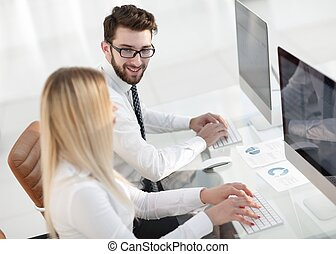 woman employee sitting at a Desk in the office