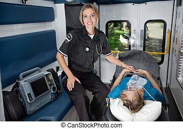 Woman EMT Professional - Female EMT professional in...