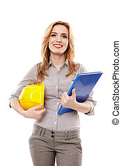 Woman engineer holding a construction plan and a helmet