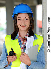 Woman engineer on site with walkie-talkie
