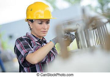 woman engineer wearing protective workwear - outdoor