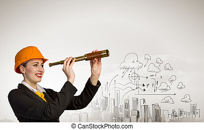 Woman engineer with scope - Woman engineer in helmet with...