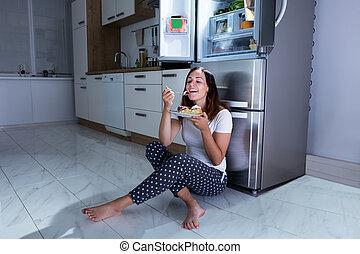 Woman Enjoy Eating Sweet Food In Kitchen