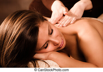 back massage - woman enjoy in back massage in spa salon
