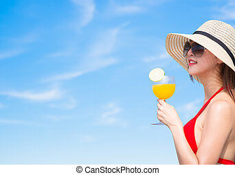 woman enjoy sunshine with juice