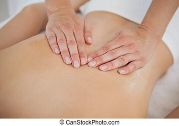 Woman enjoying a back massage  at the health spa