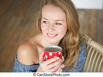 Woman enjoying a cup of tea at home