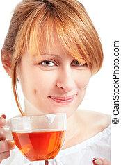 woman enjoying a cup of tea