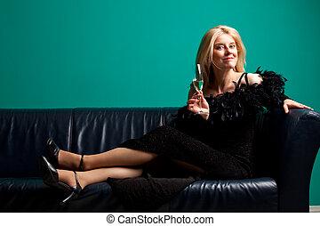 woman enjoying a glass of champagne