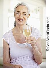Woman Enjoying A Glass Of White Wine