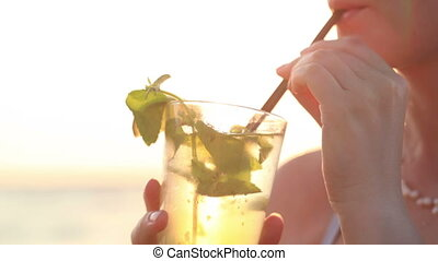 Woman enjoying a mojito cocktail