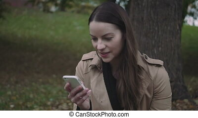 Woman enjoying a sms chat on her smartphone