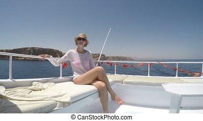 Woman enjoying a trip on yacht