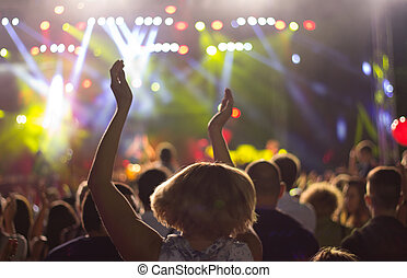 Woman enjoying at concert