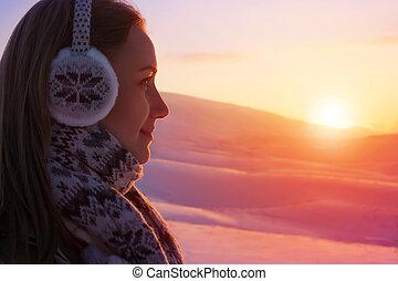 Woman enjoying beautiful sunset