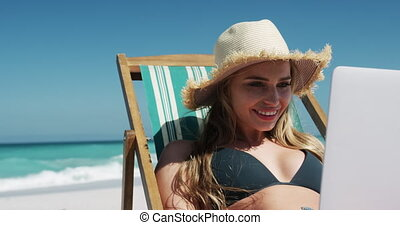 Woman enjoying free time on the beach - Front view of a ...