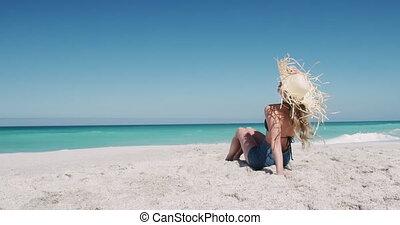 Woman enjoying free time on the beach