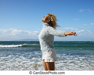 Woman enjoying freedom - Pretty young blond woman standing ...