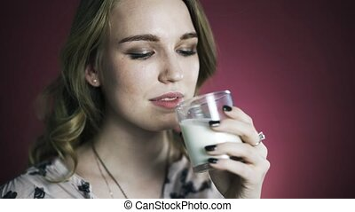 Woman enjoying fresh glass of milk. Close up locked down.