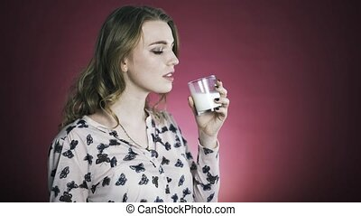 Woman enjoying fresh glass of milk. Medium shot.