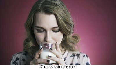 Woman enjoying fresh glass of milk. Portrait.