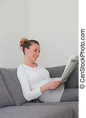 Woman enjoying her morning newspaper