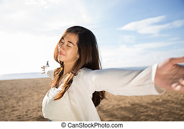 woman enjoying her time in the beach