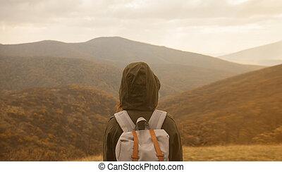 Woman enjoying landscape of autumn mountains - Hiker woman...