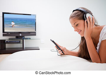 Woman enjoying music in the living room