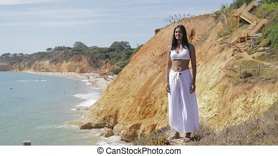 Woman enjoying nature and sunlight - Young girl in white...