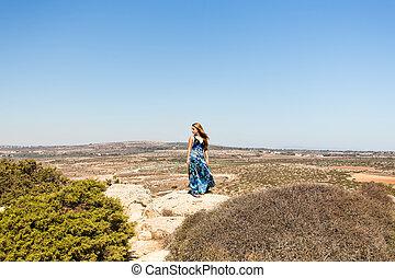 Woman enjoying nature.