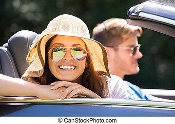 Woman Enjoying Ride In A Car