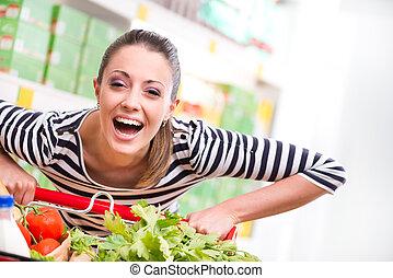 Woman enjoying shopping at supermarket