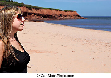 Woman enjoying Summertime at the beach in Nova Scotia