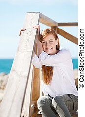 Woman enjoying the coastal sunshine