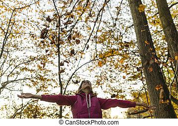 Woman enjoying the fall
